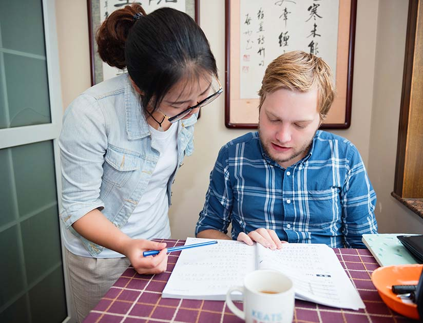 A Keats School student is having an intensive one-on-one Chinese lesson with his Chinese teacher
